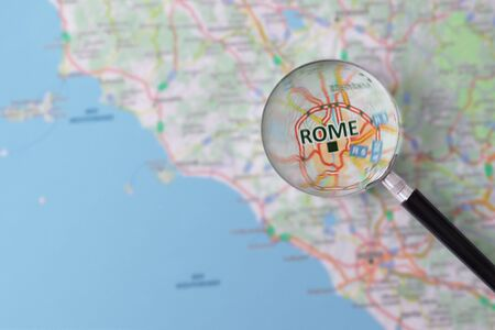 consulted: Map of Rome consulted with a magnifying glass highlighting the name of the city