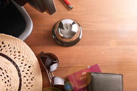 stay alert: Objects of a tourist on the table in a hotel reception. Concept hotel, travel, room. Top view Stock Photo