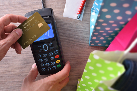 contactless: Payment in a trade with contactless card. Top view,vertical composition