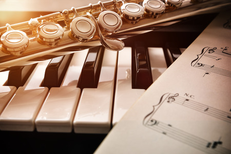 Piano and flute with golden shine and sheet music. Horizontal Composition.Front view Stok Fotoğraf