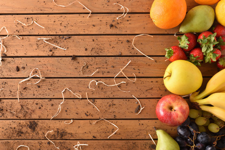 Assortment of fruits on a wooden table aligned right. Horizontal composition. Top view Stock Photo