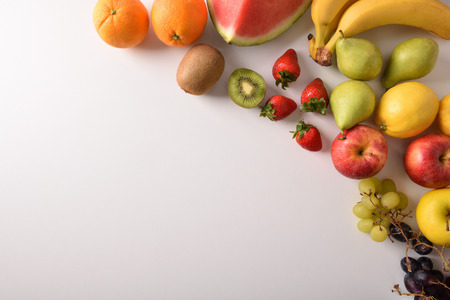 Assortment of fruits on a white table diagonal composition. Horizontal composition. Top view Stock Photo