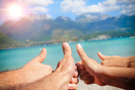 all ok: Funny tourism concept a sunny day in the sea with fingers upwards. Horizontal composition