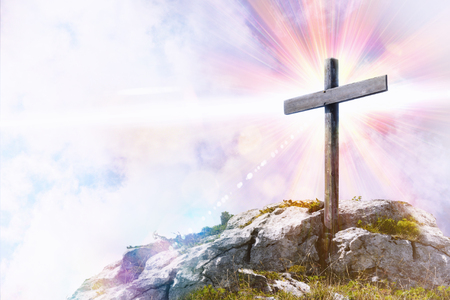 Religious illustration with cross with glitter on top of a hill. Horizontal composition