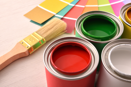 Colorful paint pots open and color palette on white table for renovation of materials close up. Elevated view. Horizontal composition. Standard-Bild - 117378443