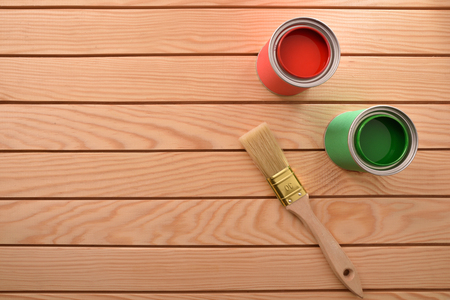 Two cans of paint for wood and brush on wooden slats. Home diy concept. Top view. Horizontal composition. Standard-Bild - 117378448