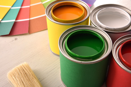 Colorful paint pots open and color palette on white table for renovation of materials close up. Elevated view. Horizontal composition. Standard-Bild - 117378454