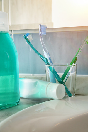 Toothbrushes, toothpaste and on a sink. Vertical composition. Front view. Reklamní fotografie