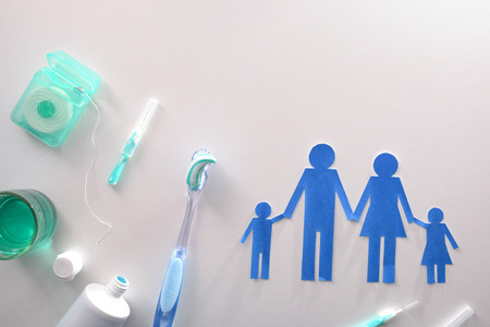 Concept of oral hygiene for the family with tools and products on white table. Horizontal composition. Top view Stok Fotoğraf