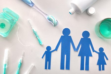 Concept of oral hygiene for the family with tools and products on white table. Horizontal composition. Top view Imagens