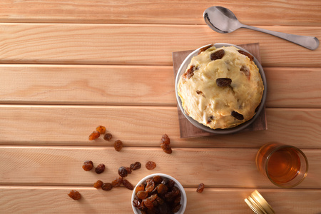 Rum with raisins ice cream cup decorated with raisins on a wooden table. Horizontal composition. Top view.