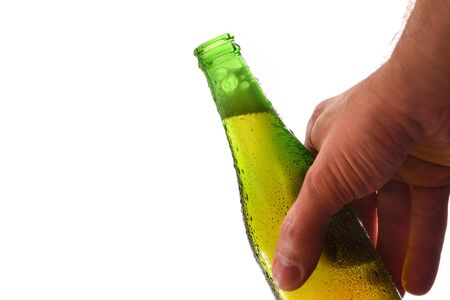 Hand holding green bottle with alcohol with white background. Horizontal composition. Front view. Stok Fotoğraf