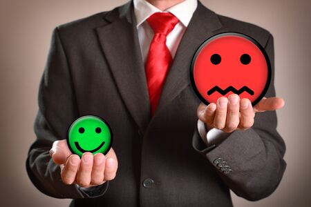 Businessman with emoticons in his hands representing failure. Horizontal composition. Front view. Stok Fotoğraf