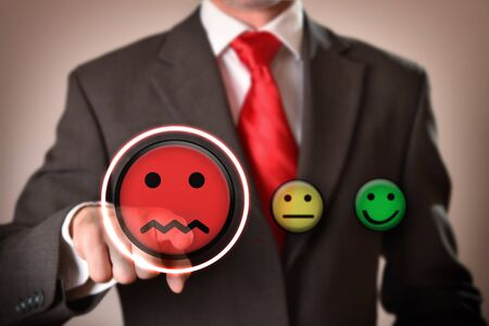 Failure concept with businessman pointing out sad emoticon. Horizontal composition. Front view.