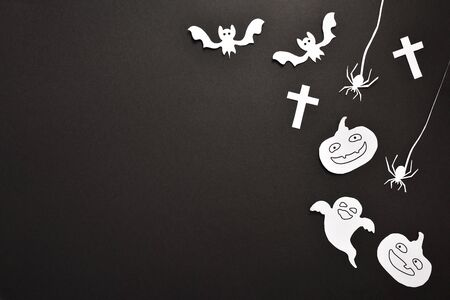 Halloween craft background with white paper cutouts on black cardboard. with space to the left. Horizontal composition. Stok Fotoğraf