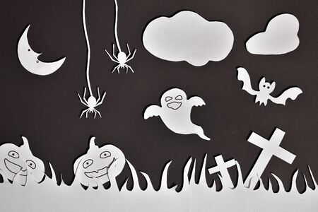Halloween composition with white paper cutouts on black cardboard general. Horizontal composition. Stok Fotoğraf