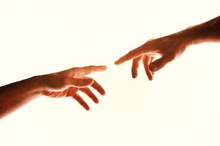 Two hands with fingers that almost touch. Representation of the Christian concept of the creation of man on earth. Horizontal composition Stock Photo