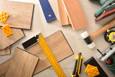 Parquet slats and tools for DIY at home. Top view. Horizontal composition. Reklamní fotografie