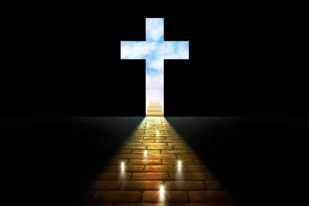 Concept of souls entering the kingdom of heaven with lights on stone pavers leading to a cross cut out on a black background with stairs and sky behind