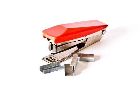 Red Stapler with staples isolated on white background photo