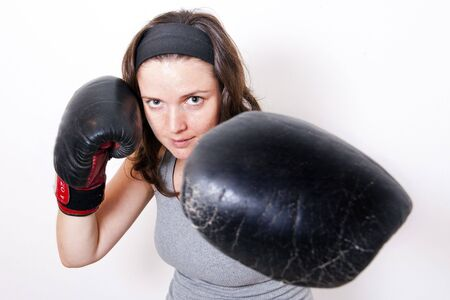 boxing young women on light background photo