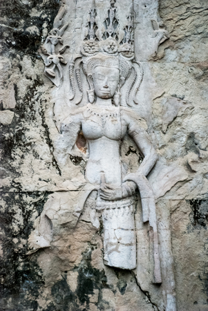 Ancient carvings in the temple complex of Angkor Wat in Cambodia. Stok Fotoğraf - 88789241