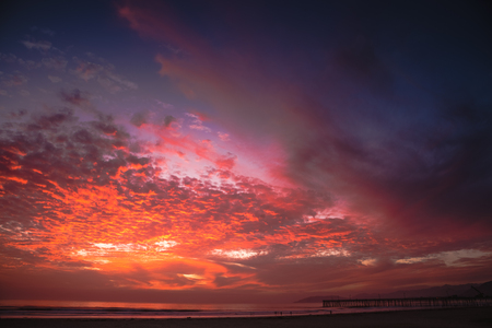 A cloudy-colorful sunset in Pismo Beach, California. Stok Fotoğraf