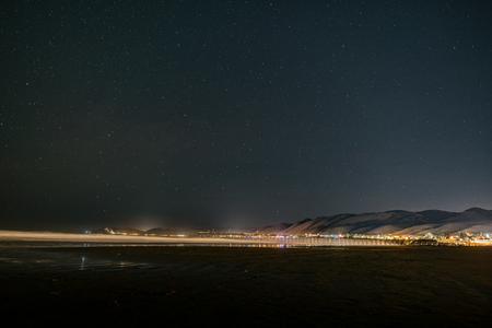 The night sky over the Pismo Beach pier. Stok Fotoğraf