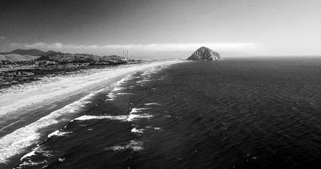 Aerial shot of Morro Rock in Morro Bay California, in black and white.