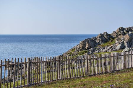 A fence by the blue sea