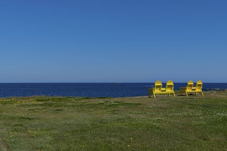 Chairs on the landscape looking at the ocean. Reklamní fotografie