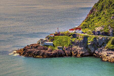 An old light house by the sea Фото со стока
