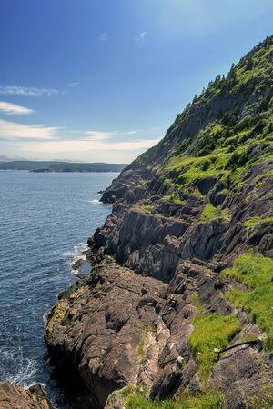 Cliff, sky and the blue ocean 版權商用圖片