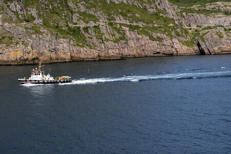 A fishing boat in the harbour in the summer time.