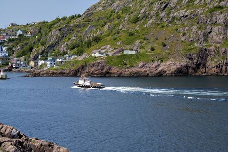 A tugboat in the harbour in the summer time.