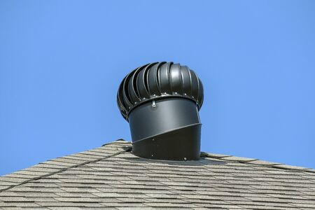 A steel, black roof vent