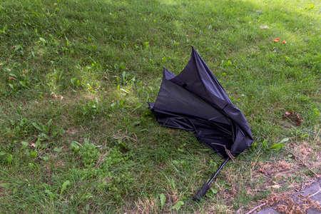 An old broken black umbrella