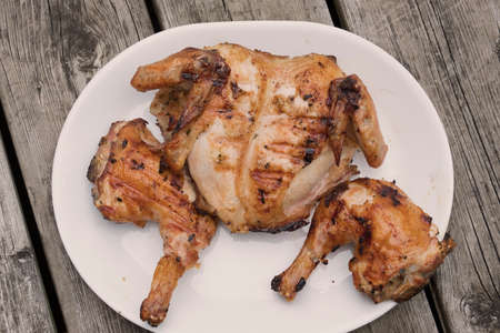 A whole chicken an a grill Stock Photo