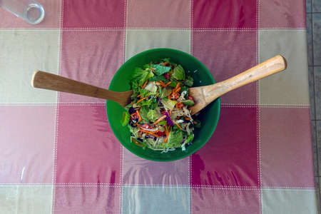 A healthy salad in a wooden bowe.