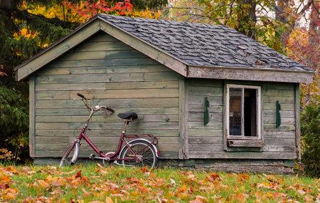 An old bike resting on cottage
