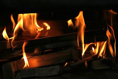 flametongue: Logs and wood burning up increasing the heat in the oven Stock Photo