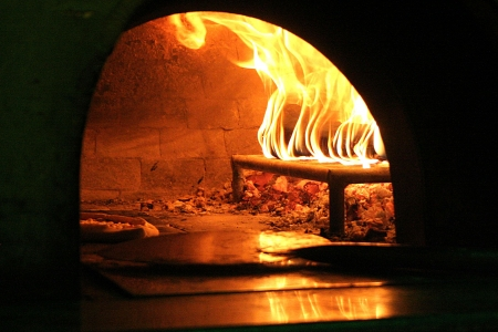 pizza oven: Pizza oven using wood with the pizza and tool inside