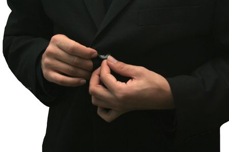 Businessman buttoning buttons up his suit Stock Photo - 2522383