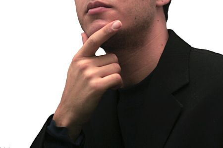 Business man contemplating and thinking with hand on chin photo