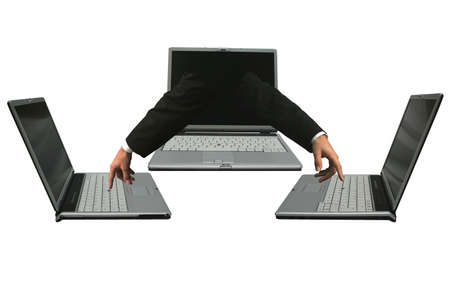 Left and right hands out of a laptop  computer working on two other laptops. Network concept. Stock Photo