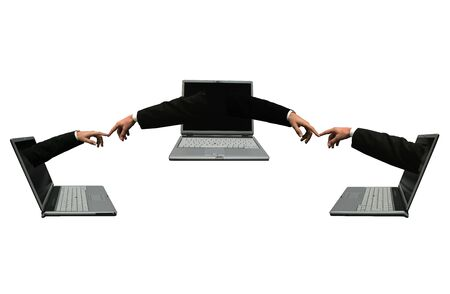 Three laptops computer with hands out of the screens touching each other. Symbolising a network Stock Photo