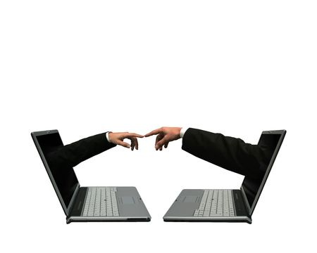 people connected: Two laptops computer with hands out of the screens touching each other. Symbolising a network