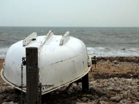 upturned: Boat by the sea