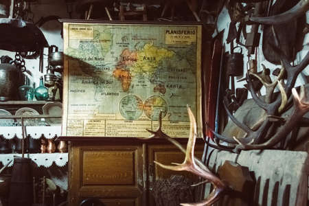 Antique shop with world map, deer antlers and other antique objects
