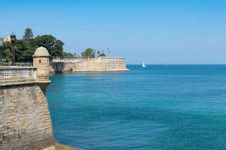 Cadiz Walls of San Carlos and Baluarte de la Candelaria. With the blue sea and sky. Andalusia, Spain Stock Photo